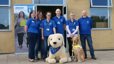 Guide Dogs team with a mascot and a guide dog