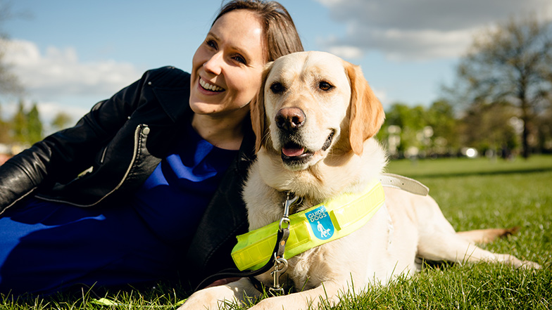 Woman-with-guide-dog-in-park-Guide-Dogs