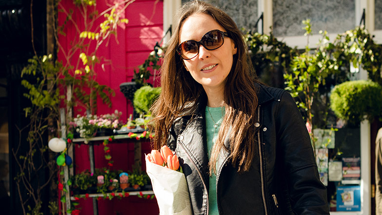 Woman with sight loss wears sunglasses outdoors
