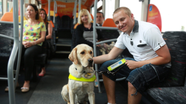 guide dog owner and dog sat on bus