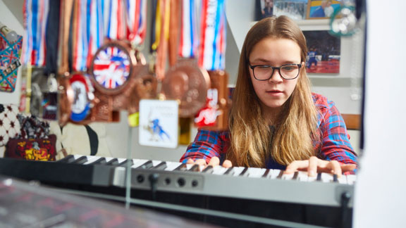 Caitlin playing a keyboard