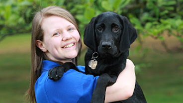 Rach and guide dog puppy in training Yuri