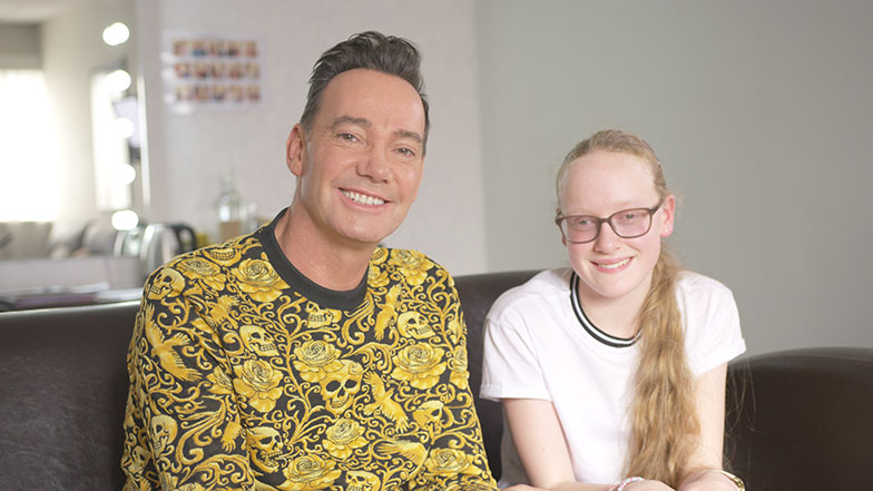 Craig Revel Horwood sitting with Neve smiling