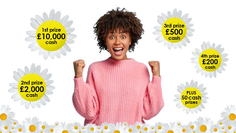Smiling woman with daisies showing prize amounts