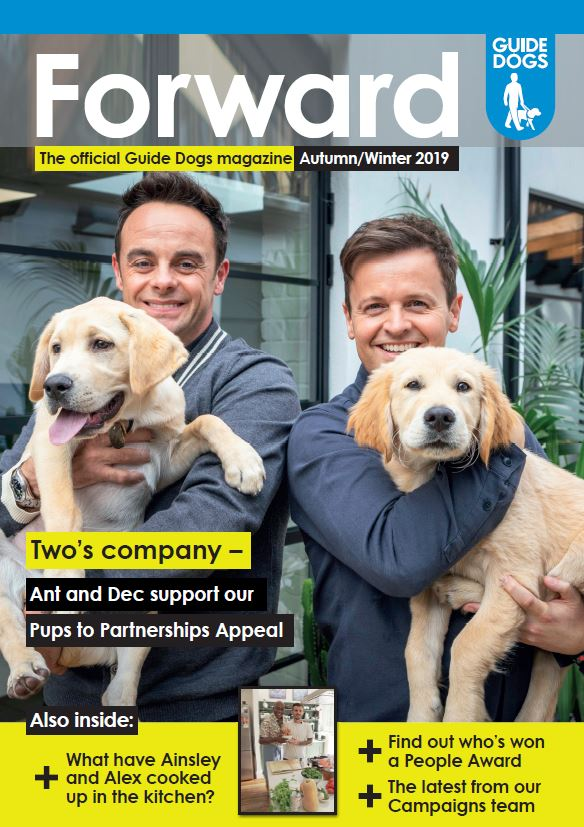 Front cover of Guide Dogs' Forward magazine, showing  celebrities Ant & Dec each holding a guide dog puppy