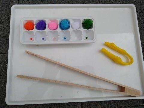 Tray with tongs and pom poms