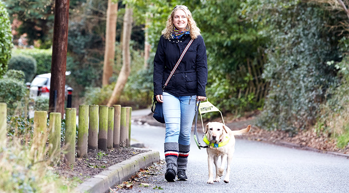 Volunteer Anica walks with her guide dog