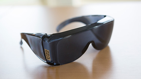 A pair of fit over u22 anti-glare shields on a table