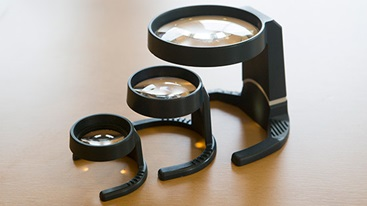 Three different strength and size illuminated stand magnifiers